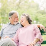 happy asian senior couple laughing